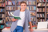 Confident young man holding book — Stock Photo