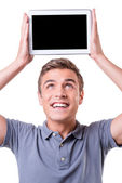 Young man holding digital tablet — Stock Photo