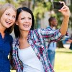 Beautiful young women making selfie — Stock Photo #50654583