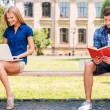 Man and woman sitting on bench — Stock Photo #50655455