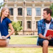 Man and woman sitting on bench — Stock Photo #50655521