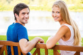Loving couple sitting on the bench — Stock Photo