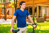 Man standing near his bicycle — Stock Photo