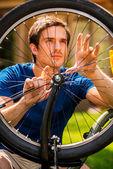 Man fixing his bike — Stock Photo