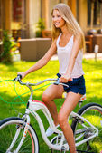 Woman smiling while riding her bicycle — Stock Photo