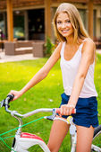 Woman  sitting on her bicycle — Stock Photo