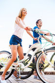 Couple sitting at their bicycles — Stock Photo