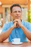 Thoughtful mature man holding hands on chin — Stock Photo