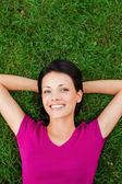 Woman lying on the green grass — Stock Photo