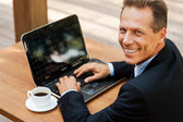 Man in formalwear working on laptop — Stock Photo