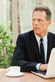 Man in formalwear  with laptop — Stock Photo