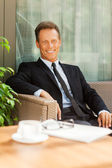 Man in formalwear sitting at the chair — Stock Photo