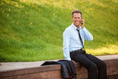 Businessman talking on the mobile phone — Stock Photo