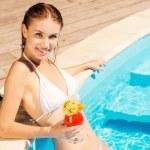 Woman in white bikini holding cocktail — Stock Photo
