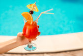 Refreshing drink in hand. — Stock Photo