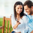 Woman showing mobile phone to boyfriend — Stock Photo #51255963
