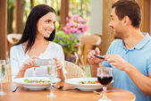Couple taking pictures of their food — Stock Photo
