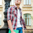 Thoughtful male student holding book — Stock Photo #51425081