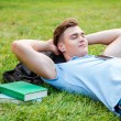 Man lying on grass and listening to MP3 Player — Stock Photo #51425317