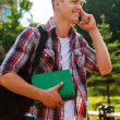 Student talking on the mobile phone and walking — Stock Photo