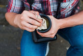 Photographer cleaning lens. — Stock Photo