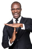 African man in formalwear gesturing time out — Stock Photo