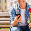 Man holding rose and mobile phone — Stock Photo #51475139