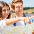 Young tourist couple holding map — Stock Photo #51475453