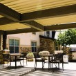 Covered hotel patio with tables — Stock Photo