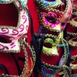 Venetian masks in rows — Stock Photo