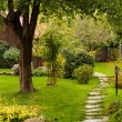 Alley in a peaceful garden — Stock Photo