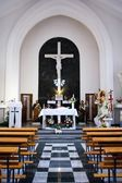 Catholic church altar and benches — Stock Photo