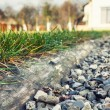 Stock Photo: Grass separated from aggregate