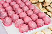 Pink cookies placed in a plateau — Stock Photo