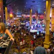 Tourists in crowded casino — Stock Photo