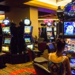 Woman having fun playing at slot machines — Stock Photo #41713391