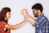 Closeup of a man fist held back by his girlfriend — Stock Photo