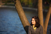 Nostalgic woman near lake — Stock Photo