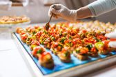 Final touch for tasty canapes — Stock Photo