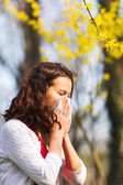 Spring allergy to flowers — Stock Photo