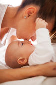 Mother kissing son's nose — Stock Photo