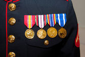 A US marine shows off his medals from active duty in the armed forces — Stock Photo