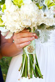Wedding Bouquet and Brooch — Stock Photo