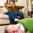 Постер, плакат: Newborn Baby Boy and Parents at Home