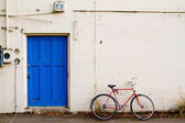 Bicycle and Blue Door — Stock Photo