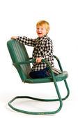 椅子の上で楽しんで少年 — ストック写真