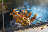 Chicken on Rotisserie BBQ — Stock Photo