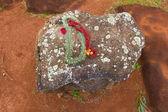 Leis on Hawaiian Birthing Stones — Stock Photo