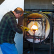 Stock Photo: MFiring Molten Glass