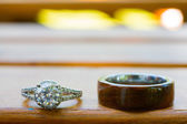 Wedding Rings on Bench — Stock Photo
